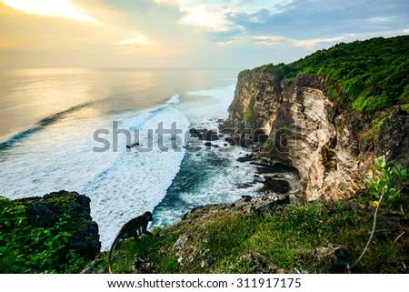 Scenic landscape of high cliff at Uluwatu Temple, Bali, Indonesia - stock photo
