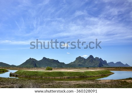 Scenic landscape of mountain and lake under the blue sky of summer at Khao Sam Roi Yot National Park, Prachuap Khiri Khan Province, Thailand