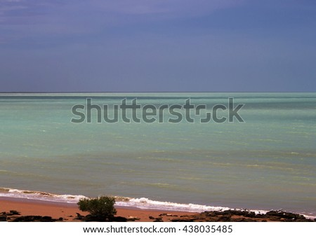 Scenic landscape of Roebuck Bay in Broome , North Western Australia , with mudflats, rocks, abundant  marine life with  big tides, mangroves, white sand  and aquamarine waters,  isolated and remote.. - stock photo
