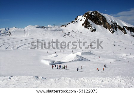 Scenic landscape of skiers in Alpine mountains with peak in background, Crans Montana, Switzerland, - stock photo