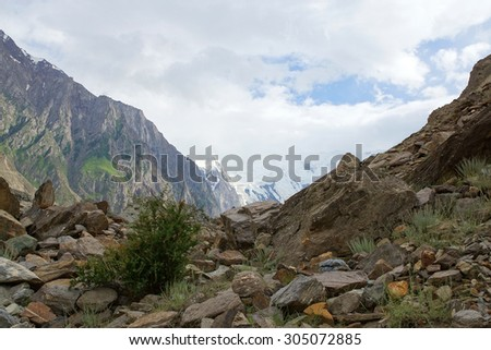 Scenic landscape - Path through the snow capped mountains - stock photo