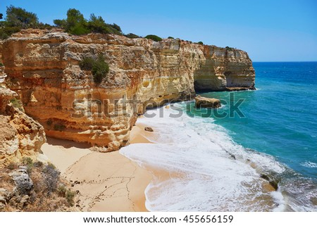 Scenic landscape with ocean, sand beaches and rocks in Algarve, Portugal - stock photo
