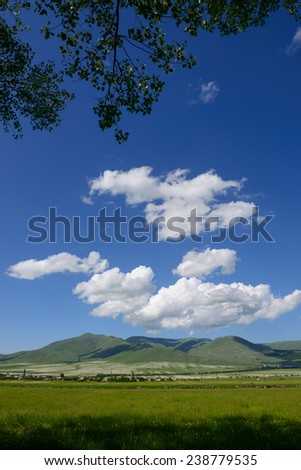 Scenic landscape with spectacular clouds  - stock photo
