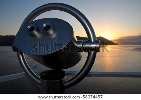 Scenic lookout binoculars at sunrise at the Norwegian fjord