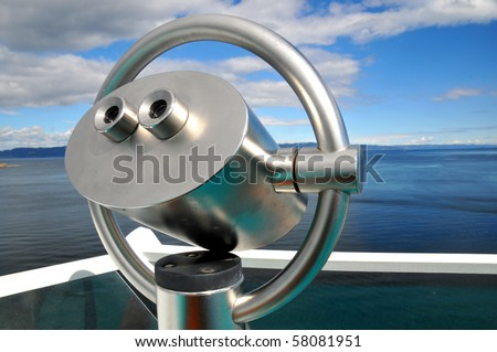 Scenic lookout Binoculars at the sea, blue sky - stock photo