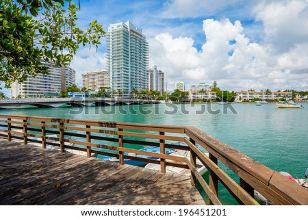 Scenic Miami Beach view of the Venetian Causeway with sailboats and condos along the bay. - stock photo