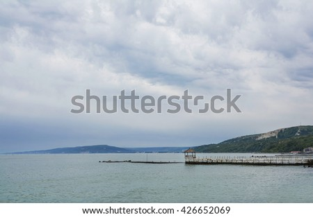 Scenic moody landscape with a pier on the shore of the Black Sea at Balchik, coastal town and seaside resort in Bulgaria