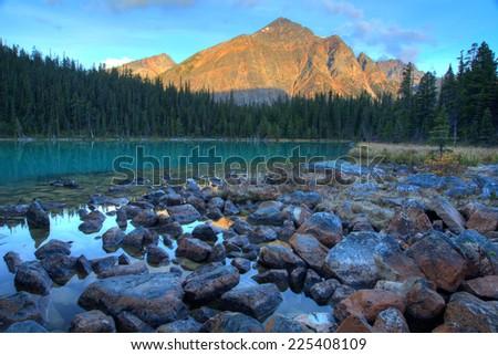 Scenic morning Cavell lake near Jasper, Canada - stock photo