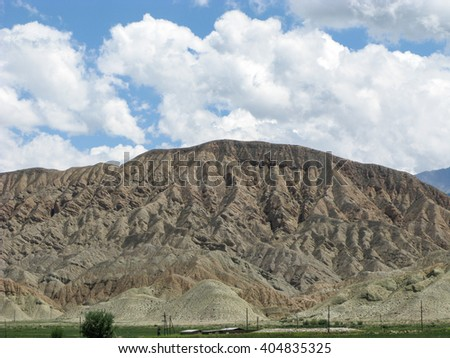Scenic mountain in the valley of Kyrgyzstan.  - stock photo