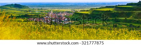 Scenic mountain panorama with vineyards and old picturesque village in Germany at sunset, Black forest, Kaiserstuhl, Oberrotweil.Travel and wine-making background. - stock photo