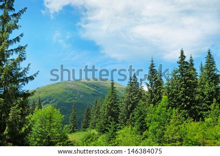 scenic mountain peaks against the blue sky