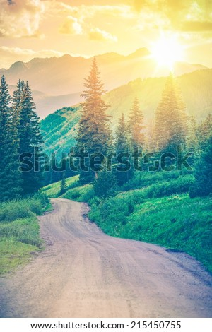 Scenic Mountain Road. Gravel Road Through Wonderful Colorado Landscape Scenery. Dream Road. Colorful Color Grading. - stock photo