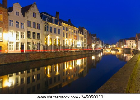 Scenic night cityscape with views of Spiegelrei, Canal Spiegel, in Bruges, Belgium - stock photo
