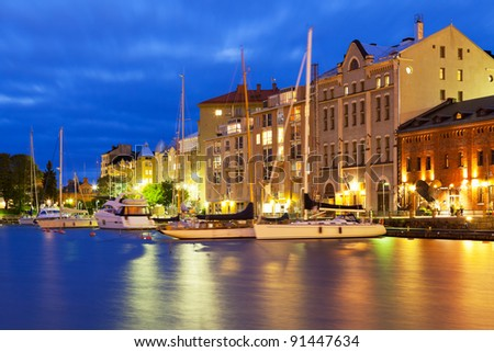 Scenic night view of the Old Port in Katajanokka district of the Old Town in Helsinki, Finland - stock photo