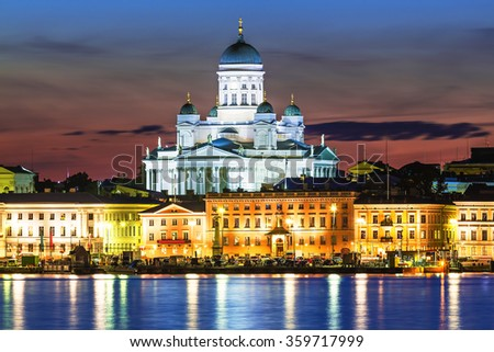 Scenic night view of the Old Town architecture and pier with Market Square and Lutheran Christian Cathedral Church at the Senate Square in Helsinki, Finland