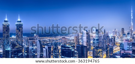Scenic nighttime skyline with illuminated architecture of Dubai downtown, United Arab Emirates.