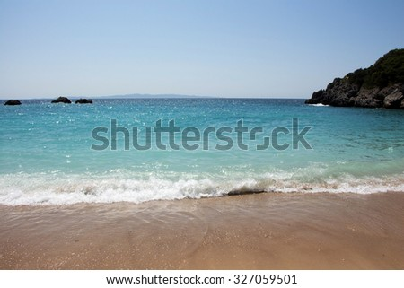 Scenic of a bay with turquoise waters and wet sand