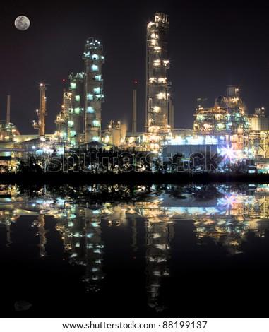 scenic of petrochemical oil refinery plant shines at night, closeup - stock photo