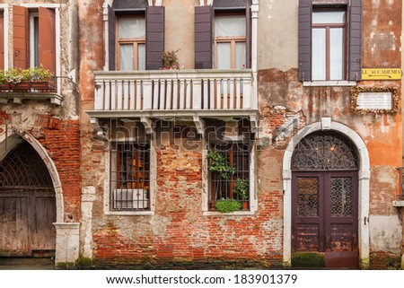 Scenic old houses along a canal in Venice, the lagoon of Italy