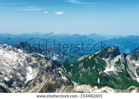 Scenic Overview of Green German Alpine Mountains and Hochvogel on Sunny Day with Blue Sky - stock photo