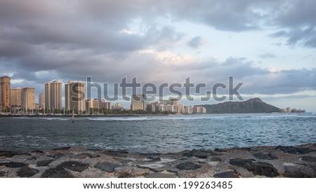 Scenic panaramic image with Diamond Head, Waikiki Beach, and Honolulu on the beautiful Hawaiian Island of Oahu - stock photo
