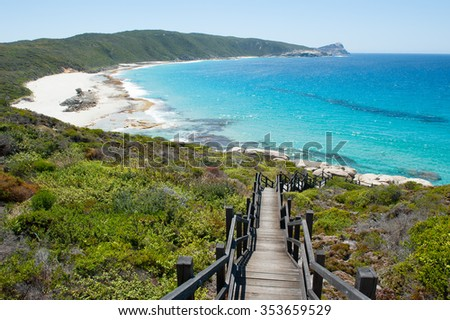 Scenic panorama of cliff coast and Cable Beach at Torndirrup National Park, Albany, Western Australia, wild Southern Ocean, blue sky, copy space. - stock photo