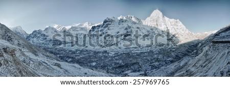 Scenic panorama of glacier in Himalayas near Kanchenjunga in Nepal - stock photo