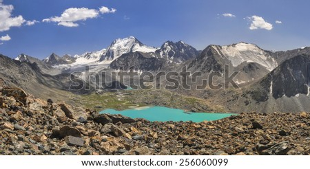 Scenic panorama of picturesque turquoise lakes in Tien-Shan mountains in Kyrgyzstan - stock photo