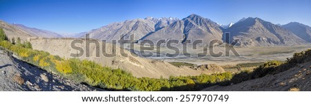 Scenic panorama of valley on arid landscape in Tajikistan on sunny day
