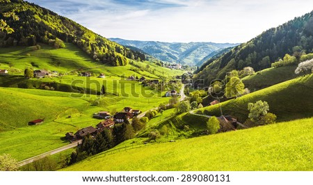 Scenic panorama view of a picturesque mountain village in Germany, Muenstertal, Black Forest. High-resolution summer vacation and ecology background. - stock photo