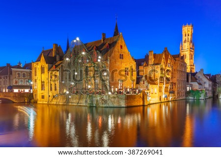 Scenic panorama with medieval fairytale town and tower Belfort from the quay Rosary, Rozenhoedkaai, in the evening, Bruges, Belgium - stock photo