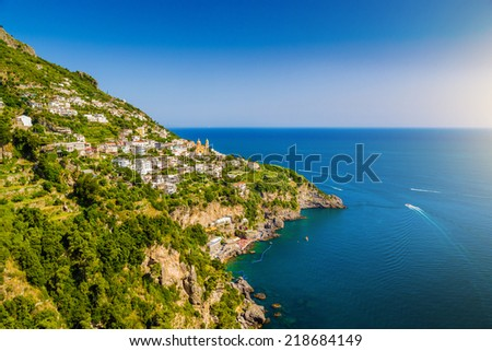 Scenic picture-postcard view of famous Amalfi Coast with Gulf of Salerno in beautiful evening light, Campania, Italy - stock photo