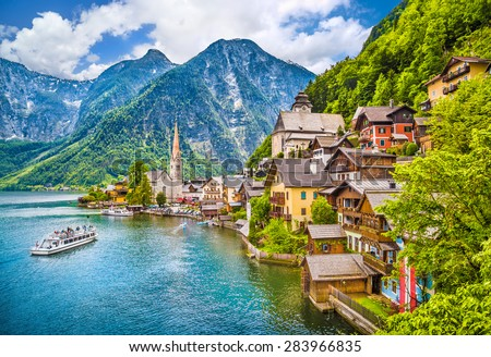 Scenic picture-postcard view of famous Hallstatt mountain village with Hallstaetter Lake in the Austrian Alps, region of Salzkammergut, Austria - stock photo