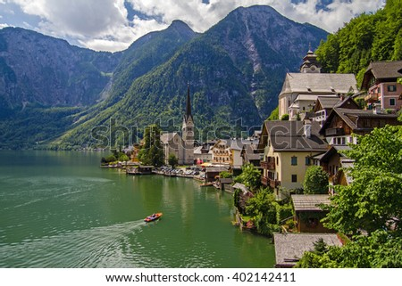 Scenic picture-postcard view of famous Hallstatt mountain village with Hallstaetter Lake in the Austrian Alps, region of Salzkammergut, Austria. Beautiful background with rural houses, lake, mountains - stock photo