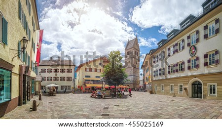 Scenic picture-postcard view of historic town square of Zell am See with traditional colorful houses and St. Hippolyte's Church in the Austrian Alps on a sunny day in summer, Salzburger Land, Austria