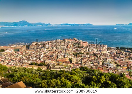 Scenic picture-postcard view of the city of Napoli (Naples) with the Gulf of Naples in golden evening light at sunset, Campania, Italy - stock photo