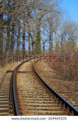 Scenic railroad in spring in remote rural area -selective blur - stock photo