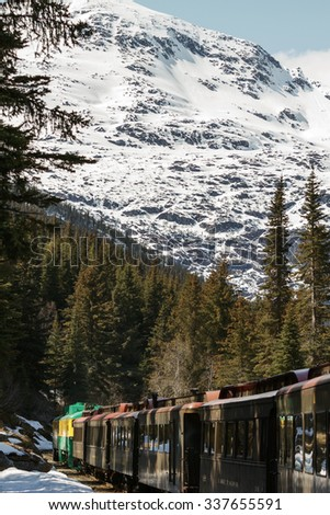 Scenic Railroad on White Pass and Yukon Route while entering tunnel in Skagway Alaska - stock photo