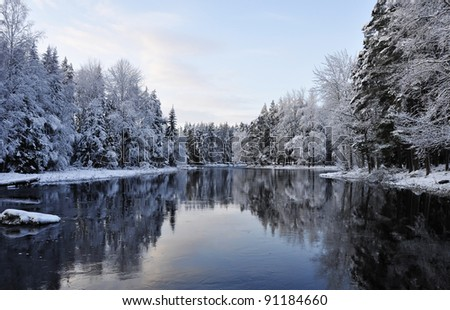 Scenic river in winter - stock photo