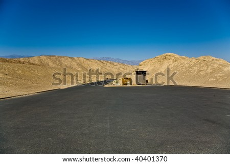 scenic road Artists Drive in Death valley, empty parking place - stock photo