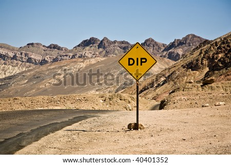 scenic road Artists Drive in Death valley with colorful stones, hills  with minerals, , road sign DIP for hilly road