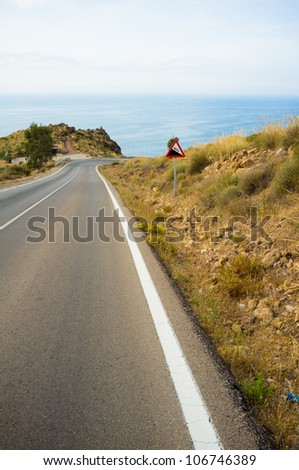 Scenic road running high above the Mediterranean - stock photo