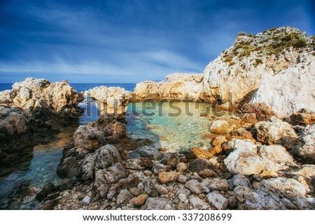 Scenic rocky coastline Cape Milazzo.Sicily, Italy. - stock photo