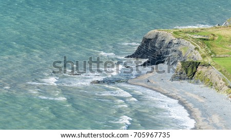 Scenic Rocky Shore of Welsh Coastline at Bright Sunny Day