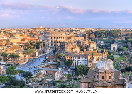 Scenic Roman Forum and Great Colosseum ( Coliseum, Colosseo, Flavian Amphitheatre ),at sunset time. Picturesque urban landscape. Aerial panoramic view on famous touristic landmark.Rome.Italy.Europe. - stock photo