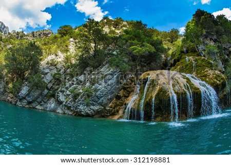 Scenic round waterfall in the side wall of the canyon Verdon. National park Merkantur, Provence, France. Photo taken fisheye lens - stock photo