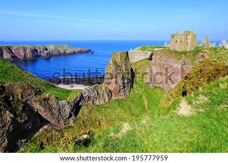 Scenic ruins of Dunnottar Castle along the coast of Scotland  - stock photo