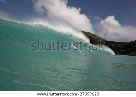 scenic shot with wave breaking - stock photo