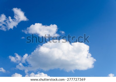Scenic Skyscape of White Puffy Clouds in Blue Sky - stock photo