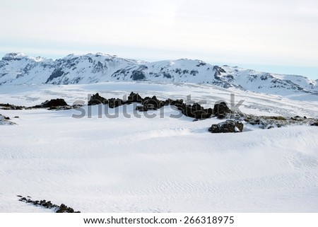 Scenic snow covered land and mountains in Iceland during winter. - stock photo